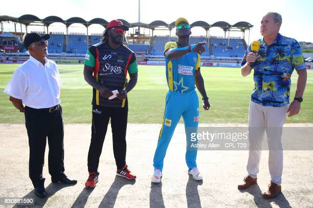 In this handout image provided by CPL T20 From Left Match Referee Dev Govinjee Chris Gayle captain of the St Kitts and Nevis Patriots Darren Sammy...