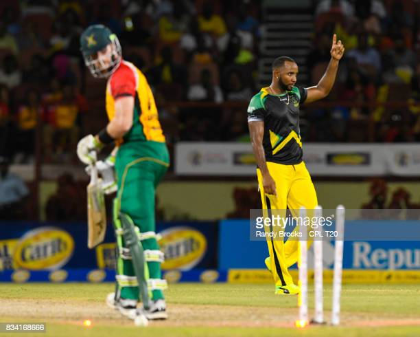 In this handout image provided by CPL T20 Garey Mathurin of Jamaica Tallawahs celebrates the dismissal of Martin Guptill of Guyana Amazon Warriors...