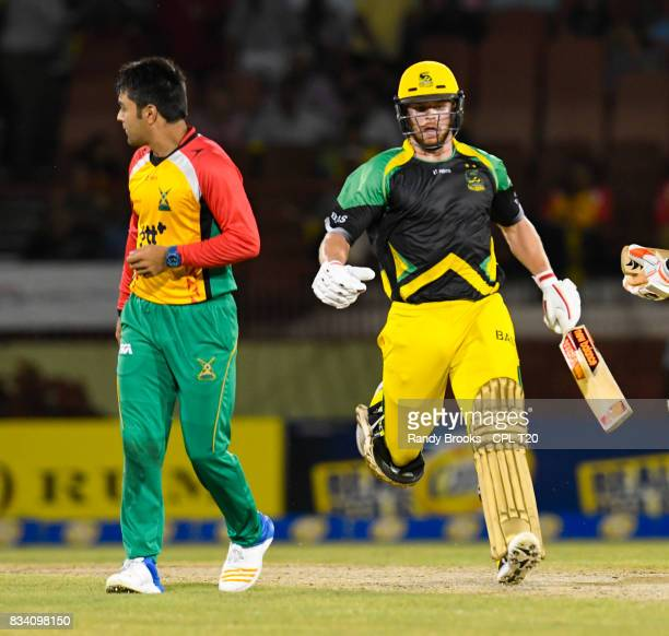 In this handout image provided by CPL T20 Glen Phillip of Jamaica Tallawahs get runs off Rashid Khan of Guyana Amazon Warriors during Match 15 of the...