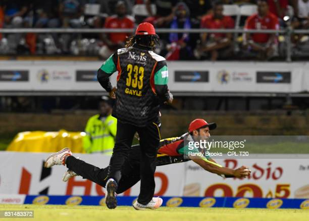 In this handout image provided by CPL T20 Hasan Ali of St Kitts Nevis Patriots takes the catch to dismiss of Trinbago Knight Riders during Match 13...