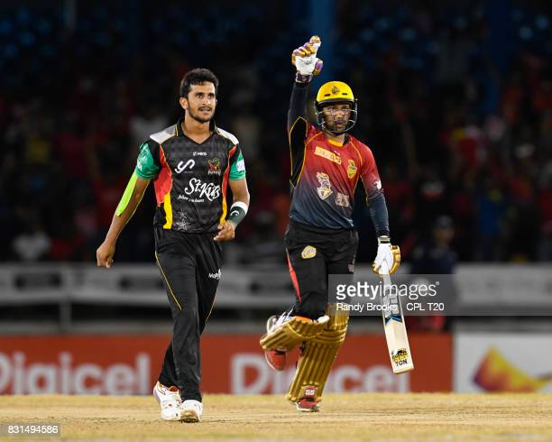 In this handout image provided by CPL T20 Hasan Ali of St Kitts Nevis Patriots watch the last ball go for 4 off Denesh Ramdin of Trinbago Knight...