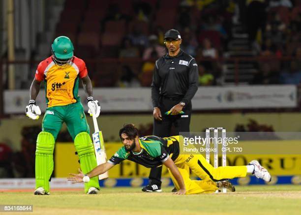 In this handout image provided by CPL T20 Imad Wasim of Jamaica Tallawahs fielding as Chadwick Walton of Guyana Amazon Warriors and Gregory...