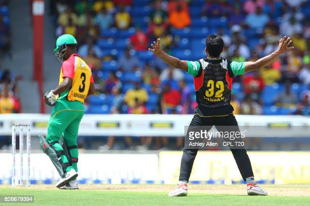 In this handout image provided by CPL T20 Jason Mohammed of Guyana Amazon Warriors is dsmissed by Hasan Ali of the St Kitts and Nevis Patriots during...