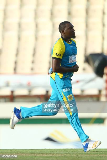 In this handout image provided by CPL T20 Jerome Taylor of St Lucia Stars celebrate the wicket of Mohammed Hafeez of the St Kitts and Nevis Patriots...