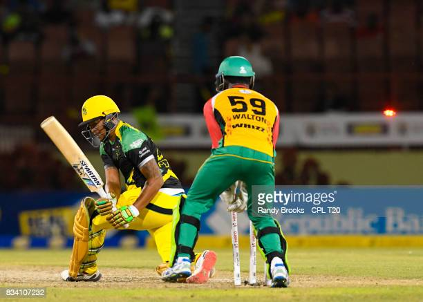 In this handout image provided by CPL T20 Jonathan Foo of Jamaica Tallawahs bowled by Rashid Khan of Guyana Amazon Warriors during Match 15 of the...
