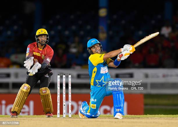 In this handout image provided by CPL T20 Kamran Akmal of St Lucia Stars hits 6 during Match 6 of the 2017 Hero Caribbean Premier League between St...