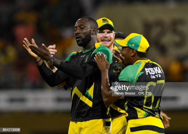 In this handout image provided by CPL T20 Kesrick Williams Glen Phillip and Krishmar Santokie of Jamaica Tallawahs celebrate winning Match 15 of the...