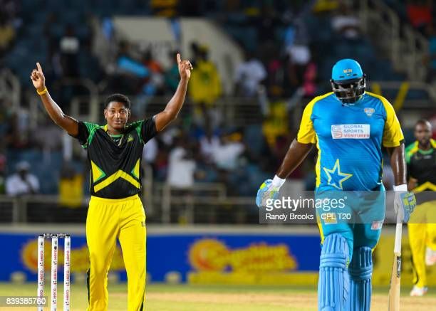 In this handout image provided by CPL T20 Krishmar Santokie of Jamaica Tallawahs celebrates the dismissal of Rahkeem Cornwall of St Lucia Stars...