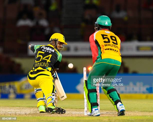 In this handout image provided by CPL T20 Lendl Simmons of Jamaica Tallawahs bolwed by Rashid Khan of Guyana Amazon Warriors during Match 15 of the...
