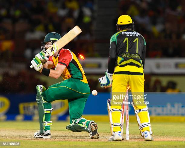 In this handout image provided by CPL T20 Martin Guptill of Guyana Amazon Warriors bowled by Garey Mathurin of Jamaica Tallawahs during Match 15 of...