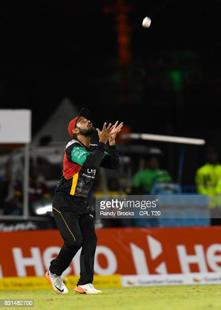 In this handout image provided by CPL T20 Mohammad Hafeez of St Kitts Nevis Patriots takes the catch to dismiss Brendon McCullum of Trinbago Knight...