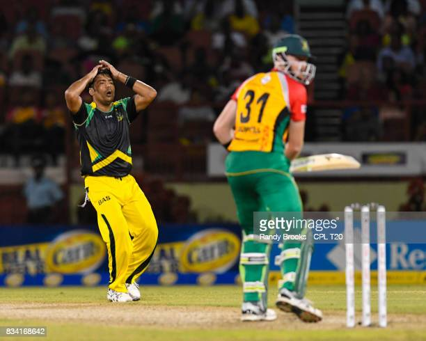 In this handout image provided by CPL T20 Mohammad Sami of Jamaica Tallawahs disappointed Martin Guptill of Guyana Amazon Warriors get runs during...