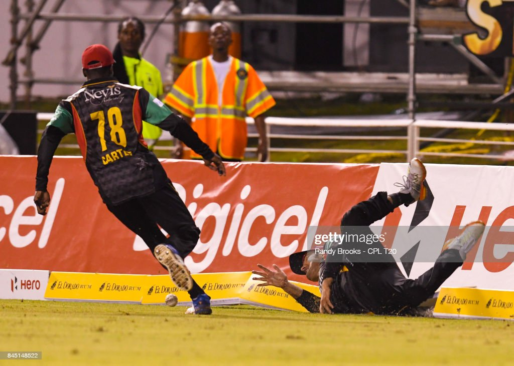 In this handout image provided by CPL T20, Mohammed Nabi (R) of St Kitts & Nevis Patriots fielding during the Finals of the 2017 Hero Caribbean Premier League between Trinbago Knight Riders and St Kitts & Nevis Patriots at Brian Lara Cricket Academy on September 09, 2017 in Tarouba, Trinidad.