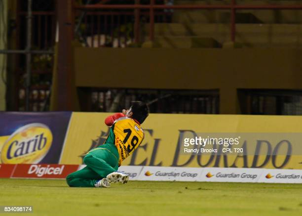 In this handout image provided by CPL T20 Rashid Khan of Guyana Amazon Warriors takes the catch to dismiss Rovman Powell of Jamaica Tallawahs during...