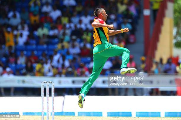 In this handout image provided by CPL T20 Rayad Emrit of Guyana Amazon Warriors celebrate the dismissal ofMohammed Hafeez of the St Kitts and Nevis...