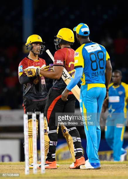 In this handout image provided by CPL T20 Shadab Khan and Javon Searles of Trinbago Knight Riders celebrate winning Match 6 of the 2017 Hero...