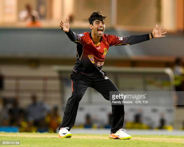 In this handout image provided by CPL T20 Shadab Khan of Trinbago Knight Riders appeals for lbw against Andre Fletcher of St Lucia Stars during Match...