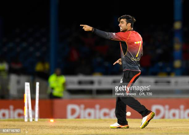 In this handout image provided by CPL T20 Shadab Khan of Trinbago Knight Riders celebrates the dismissal of Lendl Simmons of Jamaica Tallawahs during...