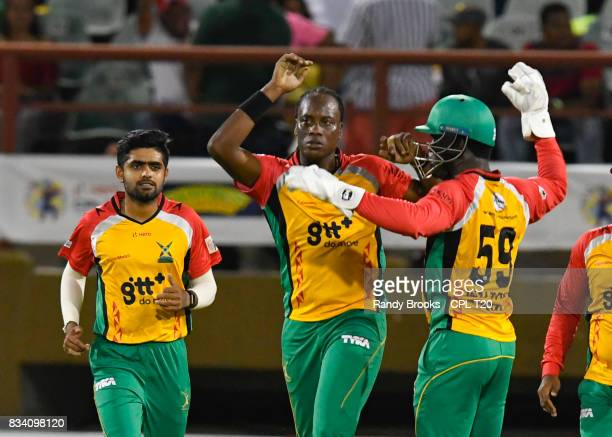 In this handout image provided by CPL T20 Steven Jacobs Babar Azam Chadwick Walton of Guyana Amazon Warriors celebrate the dismissal of Andre...