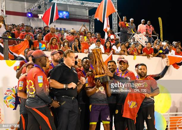In this handout image provided by CPL T20 Trinbago Knight Riders receives the trophy from Damien O'Donohoe of CPL after the Finals of the 2017 Hero...