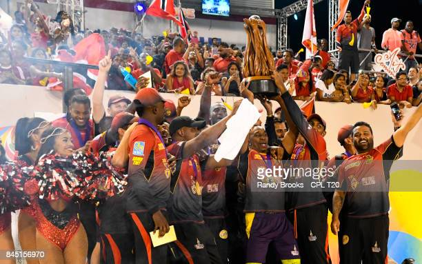 In this handout image provided by CPL T20 Trinbago Knight Riders with trophy after winning the Finals of the 2017 Hero Caribbean Premier League...