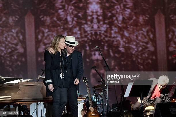 In this handout image provided by Denis Alix Elvis Costello made a rare appearance onstage with his wife Diana Krall on June 29 2014 at the Montreal...