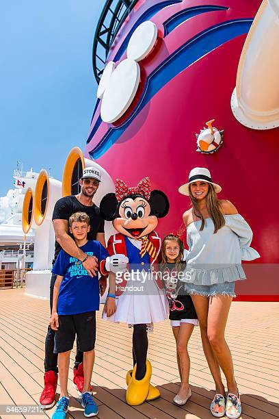 In this handout image provided by Disney Actor and 'Dancing with the Stars' alum William Levy actress Elizabeth Gutiérrez and their children...