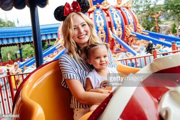 In this handout image provided by Disney Actress Candice Accola shares a special moment with her daughter Florence May after taking flight on Dumbo...