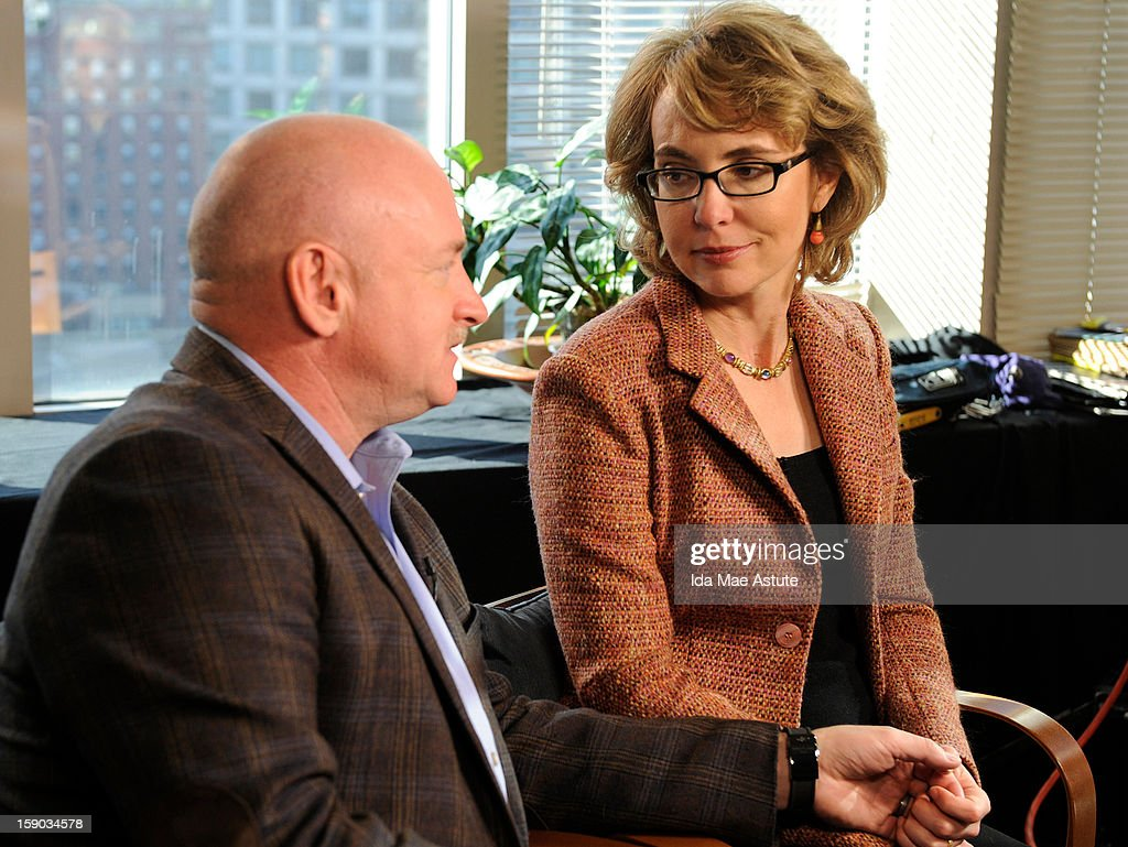 In this handout image provided by ABC, Former Congresswoman <a gi-track='captionPersonalityLinkClicked' href=/galleries/search?phrase=Gabrielle+Giffords&family=editorial&specificpeople=6961081 ng-click='$event.stopPropagation()'>Gabrielle Giffords</a>, who was critically injured two years ago when a gunman opened fired in Tucson, Arizona, and her husband, astronaut <a gi-track='captionPersonalityLinkClicked' href=/galleries/search?phrase=Mark+Kelly+-+Astronauta+y+partidario+del+control+de+armas&family=editorial&specificpeople=566699 ng-click='$event.stopPropagation()'>Mark Kelly</a> talk to Diane Sawyer about the need for changes in gun control laws and greater awareness of mental health issues on January 5, 2013 in New York City. The interview will air on all ABC News programs and platforms on January 8.