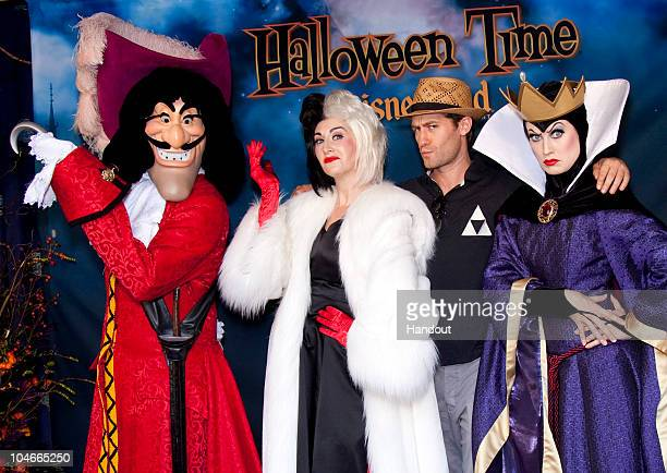 In this handout image provided by Disney 'Glee' star Matthew Morrison celebrates 'Halloween Time' with Captain Hook from 'Peter Pan' Cruella de Vil...