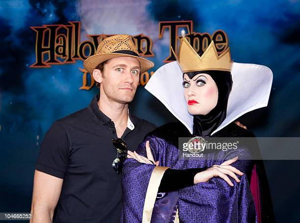 In this handout image provided by Disney 'Glee' star Matthew Morrison celebrates 'Halloween Time' with the Evil Queen from 'Snow White' at Disneyland...