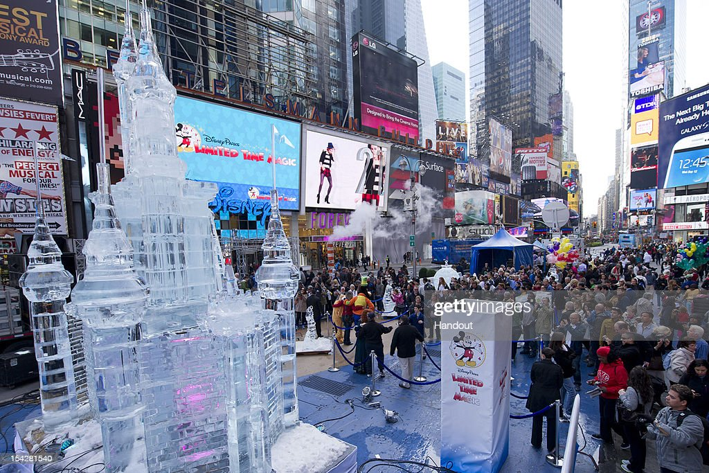In this handout image provided by Disney Parks, A crowd gathers to take photos of a Disney Parks ice sculpture in Times Square. Disney Parks unveiled the 25-foot-tall, 45,000-pound castle made of ice as the sun rose over Times Square October 17, 2012 in New York City. The icy structure was unveiled during the Disney Parks announcement of 'Limited Time Magic' that will take place throughout 2013 at Disneyland Resort in California and Walt Disney World Resort in Florida. Next year, each week at the Disney theme parks will be highlighted by a different surprise or guest enhancement for a one-week-only engagement. Each weekly surprise, many never-before-seen in the Disney Parks, will include entertainment, dining, character experiences and more. Each one will disappear after seven days and make way for the next week's Limited Time Magic experience. The ice castle in Times Square -- which took more than 12 hours to construct and craft -- demonstrates the short-lived nature of Disney's Limited Time Magic.