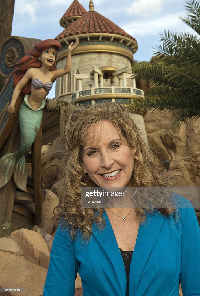 In this handout image provided by Disney Parks, actress and singer Jodi Benson, who provided the voice of Ariel in Disney's animated classic 'The Little Mermaid,' poses at the 'Under the Sea - Journey of the Little Mermaid' attraction at the Magic Kingdom theme park December 6, 2012 in Lake Buena Vista, Florida. Benson, who was named a 'Disney Legend' by The Walt Disney Co. in 2011, was one of the celebrities on hand to celebrate today's Grand Opening of 'New Fantasyland' at Walt Disney World Resort. New Fantasyland is a new area in the Magic Kingdom and is the largest expansion in the 41-year history of the theme park.