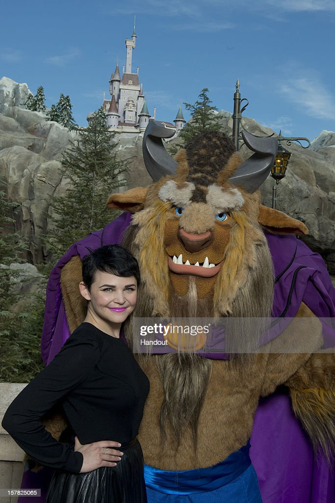In this handout image provided by Disney Parks, actress Ginnifer Goodwin, who portrays Snow White on the ABC series 'Once Upon a Time,' poses with 'Beast' from Disney's classic film, 'Beauty and the Beast,' in front of The Beast's Castle at the Magic Kingdom theme park December 6, 2012 in Lake Buena Vista, Florida. Goodwin was one of the celebrities on hand to celebrate today's Grand Opening of 'New Fantasyland' at Walt Disney World Resort. New Fantasyland is a new area in the Magic Kingdom and is the largest expansion in the 41-year history of the theme park.