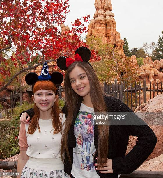 In this handout image provided by Disney Parks actress Hailee Steinfeld and fashion blogger Tavi Gevinson pose outside Big Thunder Mountain Railroad...