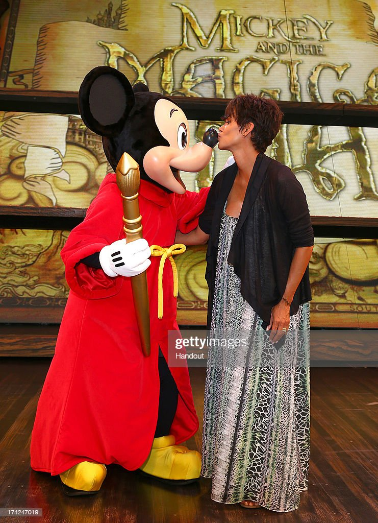 In this handout image provided by Disney Parks, actress <a gi-track='captionPersonalityLinkClicked' href=/galleries/search?phrase=Halle+Berry&family=editorial&specificpeople=201726 ng-click='$event.stopPropagation()'>Halle Berry</a> meets Mickey Mouse on the stage of the new live musical show, 'Mickey and the Magical Map,' at Disneyland July 22, 2013 in Anaheim, California.