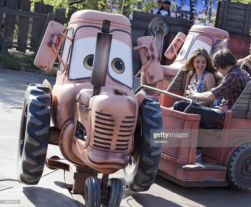 In this handout image provided by Disney Parks, actress Sarah Hyland (L), star of ABC's 'Modern Family,' takes a spin on the 'Mater's Junkyard Jamboree' attraction while enjoying Cars Land at Disney California Adventure park at Disneyland Resort June 13, 2012 in Anaheim, California. Hyland was one of the celebrities attending a gala event to celebrate the opening of the new land. Cars Land features three immersive family attractions showcasing characters and settings from the Disney-Pixar film, 'Cars.'