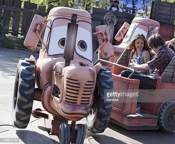 In this handout image provided by Disney Parks actress Sarah Hyland star of ABC's 'Modern Family' takes a spin on the 'Mater's Junkyard Jamboree'...