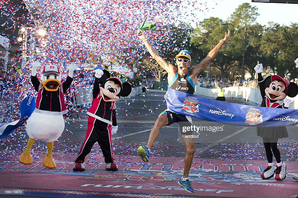 In this handout image provided by Disney Parks, Adriano Bastos of Brazil crosses the finish line January 13, 2013 to win the 20th Annual Walt Disney World Marathon presented by Cigna at Walt Disney World Resort in Lake Buena Vista, Fla. With a time of 2:21:16, Bastos claimed his eighth Disney Marathon win, an event record. The 26.2-mile race coursed through all four Disney theme parks and through the Walt Disney World Speedway and ESPN Wide World of Sports Complex. A record 65,000 runners took part in a variety of Walt Disney World Marathon Weekend events, including the Family Fun Run 5K, Mickey Mile and runDisney Kids Races, along with the half and full marathons.