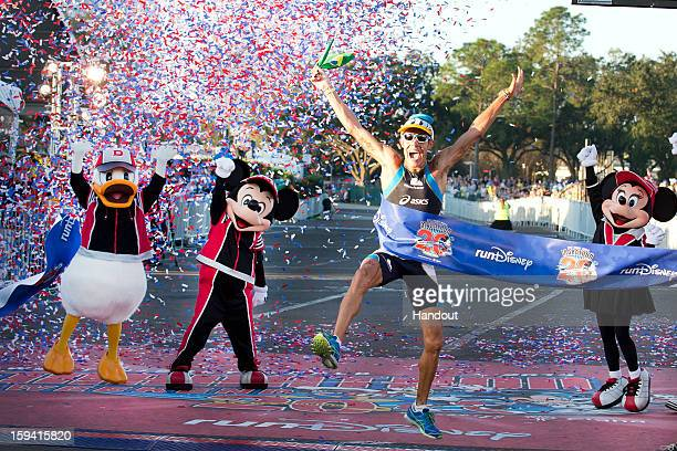In this handout image provided by Disney Parks Adriano Bastos of Brazil crosses the finish line January 13 2013 to win the 20th Annual Walt Disney...
