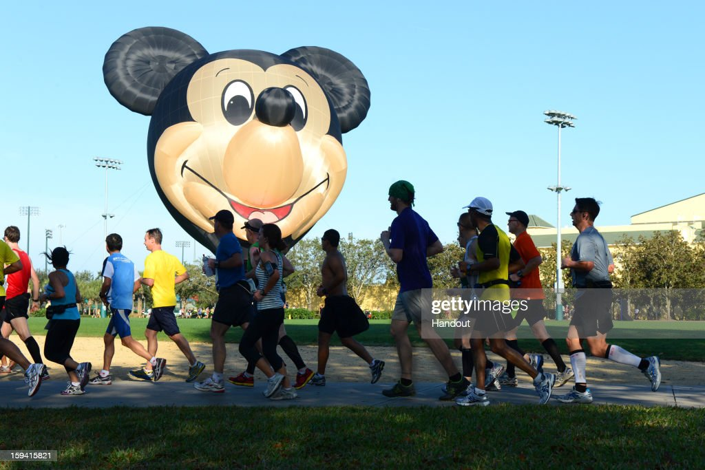 In this handout image provided by Disney Parks, athletes run by a Mickey Mouse hot air balloon Jan. 13, 2013 during the 20th Annual Walt Disney World Marathon presented by Cigna at Walt Disney World Resort in Lake Buena Vista, Fla. The 26.2-mile race coursed through all four Disney theme parks and through the Walt Disney World Speedway and ESPN Wide World of Sports Complex. A record 65,000 runners took part this year in a variety of Walt Disney World Marathon Weekend events, including the Family Fun Run 5K, Mickey Mile and runDisney Kids Races, along with the half and full marathons.