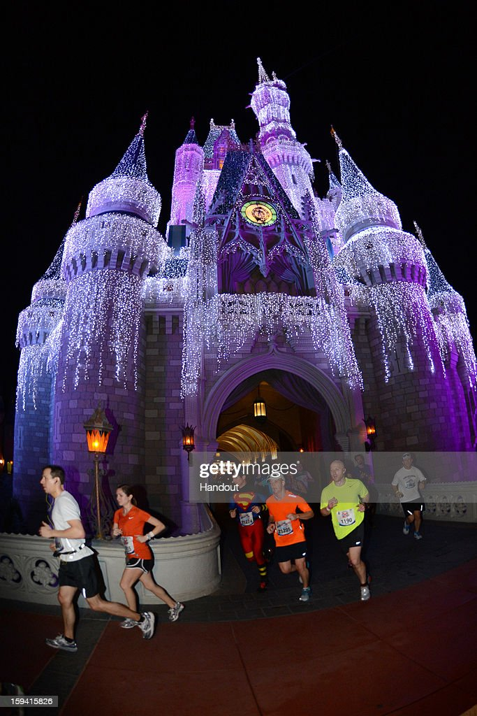 In this handout image provided by Disney Parks, athletes run through Cinderella Castle in the Magic Kingdom park January 13, 2013 during the 20th Annual Walt Disney World Marathon presented by Cigna at Walt Disney World Resort in Lake Buena Vista, Fla. The 26.2-mile race coursed through all four Disney theme parks and through the Walt Disney World Speedway and ESPN Wide World of Sports Complex. A record 65,000 runners took part this year in a variety of Walt Disney World Marathon Weekend events, including the Family Fun Run 5K, Mickey Mile and runDisney Kids Races, along with the half and full marathons.