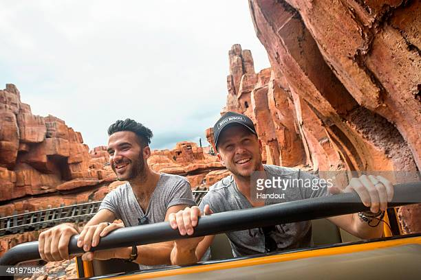 In this handout image provided by Disney Parks Brian Willett and Ryan Tedder of OneRepublic rock and roll down Big Thunder Mountain at Magic Kingdom...