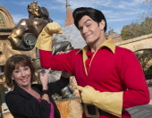 In this handout image provided by Disney Parks Broadway and recording star Paige O'Hara poses with Disney's 'Beauty and the Beast' character Gaston...