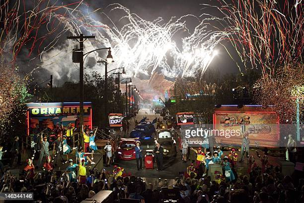In this handout image provided by Disney Parks confetti cascades while rows of bright neon signs illuminated billboards and pyrotechnics light up the...
