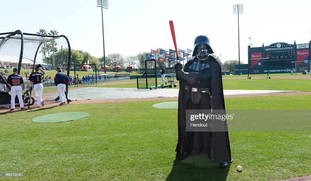 In this handout image provided by Disney Parks Darth Vader poses with a red lightsaber bat before a Braves spring training game at Champion Stadium...