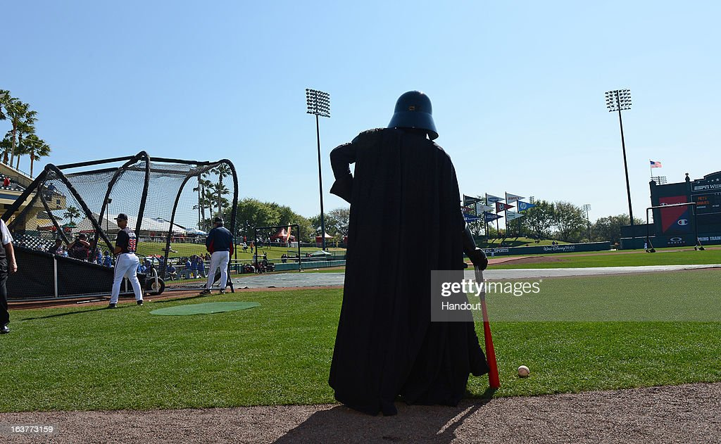 In this handout image provided by Disney Parks, Darth Vader poses with a red lightsaber bat before a Braves spring training game at Champion Stadium at ESPN Wide World of Sports Complex March 15, 2013 in Lake Buena Vista, Florida. Friday's Braves and Mets MLB game was 'Star Wars Day' at the Walt Disney World ballpark.
