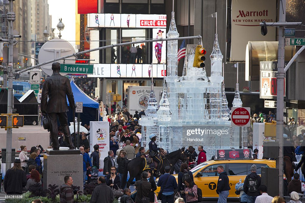 In this handout image provided by Disney Parks, Disney Parks unveiled a 25-foot-tall, 45,000-pound castle made of ice as the sun rose over Times Square October 17, 2012 in New York City. The icy structure was unveiled during the Disney Parks announcement of 'Limited Time Magic' that will take place throughout 2013 at Disneyland Resort in California and Walt Disney World Resort in Florida. Next year, each week at the Disney theme parks will be highlighted by a different surprise or guest enhancement for a one-week-only engagement. Each weekly surprise, many never-before-seen in the Disney Parks, will include entertainment, dining, character experiences and more. Each one will disappear after seven days and make way for the next week's Limited Time Magic experience. Combined with the heat of the morning and early-afternoon sun, the ice castle in Times Square -- which took more than 12 hours to construct and craft -- demonstrates the short-lived nature of Disney's Limited Time Magic.