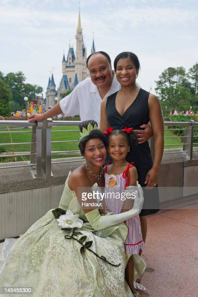 In this handout image provided by Disney Parks Disney's Princess Tiana poses with Martin Luther King III wife Arndrea and daughter Yolanda May 30...
