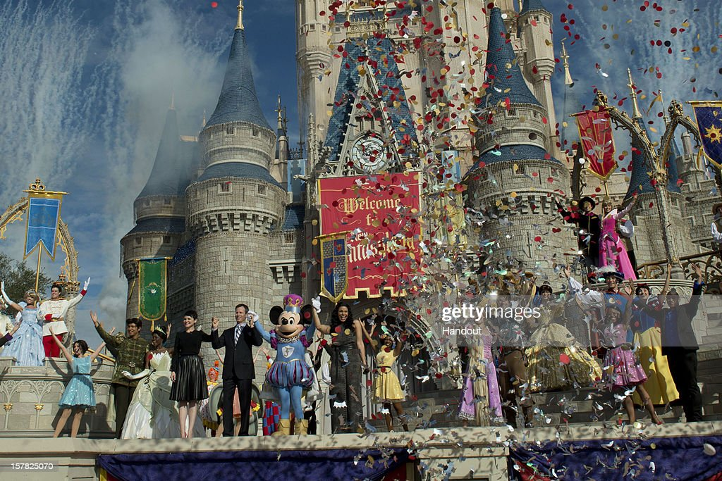 In this handout image provided by Disney Parks, fireworks and confetti fly at Cinderella Castle during the Grand Opening of New Fantasyland at Walt Disney World Resort December 6, 2012 in Lake Buena Vista, Florida. Actress <a gi-track='captionPersonalityLinkClicked' href=/galleries/search?phrase=Ginnifer+Goodwin&family=editorial&specificpeople=215039 ng-click='$event.stopPropagation()'>Ginnifer Goodwin</a>, Disney Parks and Resorts Chairman Tom Staggs, singer <a gi-track='captionPersonalityLinkClicked' href=/galleries/search?phrase=Jordin+Sparks&family=editorial&specificpeople=4165535 ng-click='$event.stopPropagation()'>Jordin Sparks</a> and Mickey Mouse joined dozens of Disney characters on Cinderella Castle stage to celebrate the opening. New Fantasyland is a new area in the Magic Kingdom and is the largest expansion in the 41-year history of the theme park.